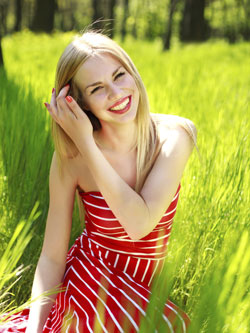girl smiling in grass