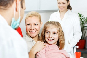 girl and mother at dentist