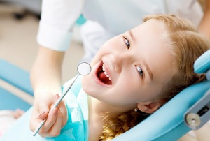 girl smiling dentist chair