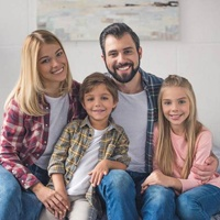 Portrait of a family smiling at home