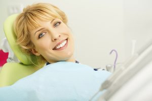 smiling person on dental chair