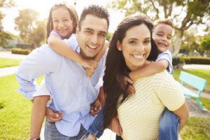 family portrait with children on parents backs
