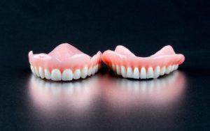 dentures on black background