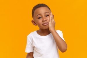 Young boy with toothache, needs to visit family dentist