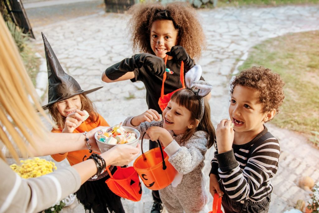 Closeup of children trick-or-treating in their costumes